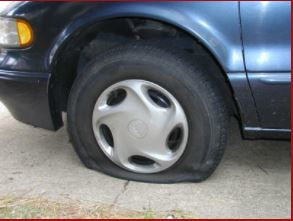 car-with-a-flat-tire