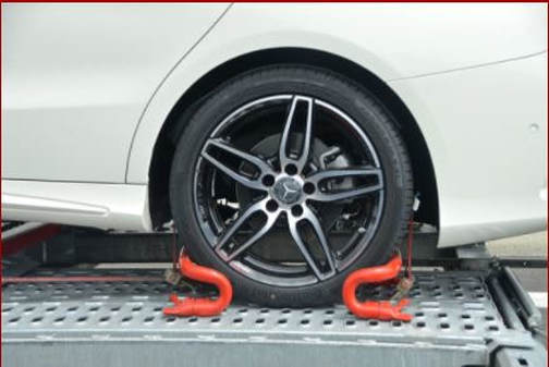 close-up-of-vehicle-tire-on-tow-truck