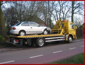 silver-car-on-a-flat-bed-tow-truck