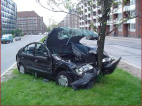 vehicle-wrapped-around-a-tree-after-an-accident